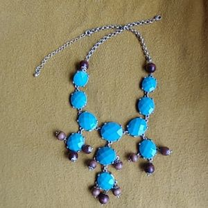 Turquoise and wooden bead necklace.